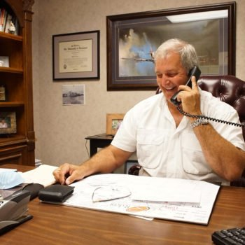 DR. Surratt talking on the phone in his office