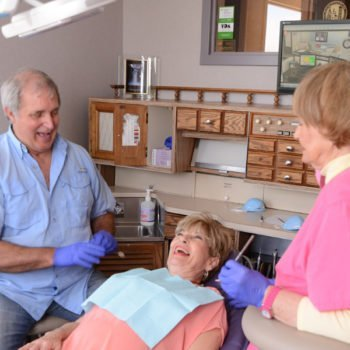 Dr. Surratt, patient and staff member laughing