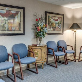 waiting room showing chairs, pictures on wall and flower arrangement